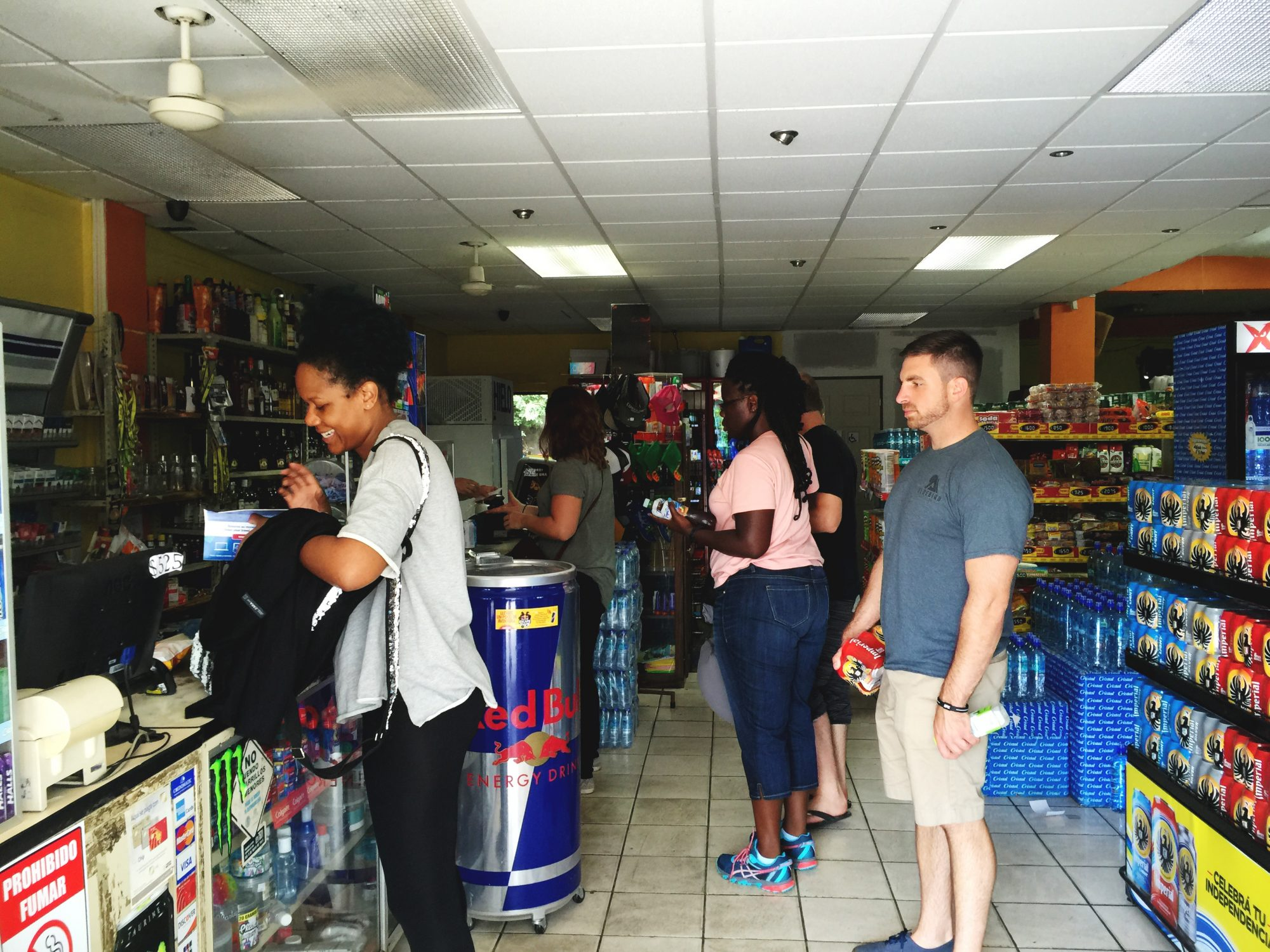 A man and woman wait to check out at a Costa Rican soda